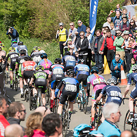 The main peloton passes through Owston, Leicestershire, during the 13th Rutland Melton International Cicle Classic between Oakham and Melton Mowbray, Leicestershire, United Kingdom, on 23 April 2017. The race is a UCI 1.2 ranked event, taking in 188km including 11 off-road sectors around Rutland and Leicestershire and was won by Dan Fleeman of the Metaltek-Kuota team.