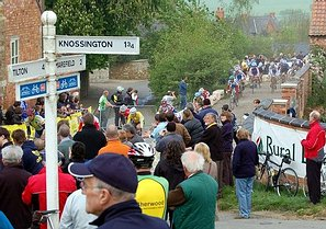 "The peleton exits the Owston Manor special sector during the 2007 CiCLE Classic in front of a large an appreciative crowd. Owston; the little village with a big 'heart', - ""Cycling Weekly"" 3rd May 2007"